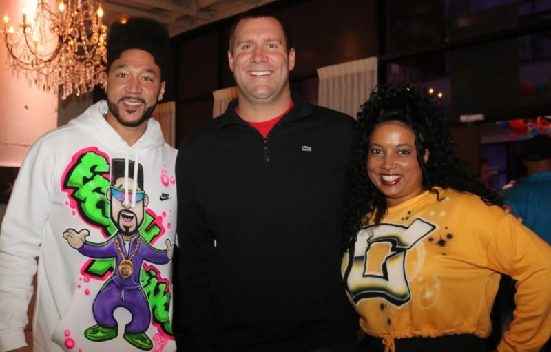 Charlie Batch, Ben Roethlisberger and Tasha Batch smiling at the In The Pocket event