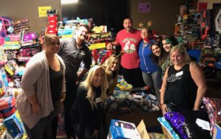 Charlie Batch and volunteers pack gifts for Batch a Toys